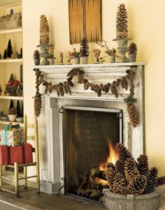Easy craft project: make a garland of pinecones and hang them on your fireplace for a homey rustic feel.