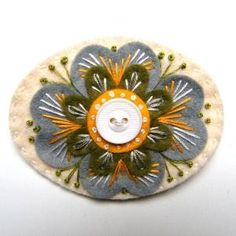 ELIZABETHAN felt brooch pin with freeform embroidery - scandinavian style via Etsy by marcella