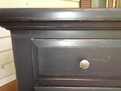 My DIY distressed furniture project by Heather Webb...Sand down any furniture piece with sandpaper, paint any color you like- I did 2 coats black over oak- then when all layers dry, roughly sand down corners, and edges- added Hobby lobby knobs!! and you have a new piece...Simply Southern!