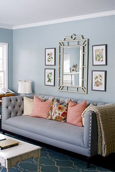 simple wall display above sofa. affordable alternative to large art