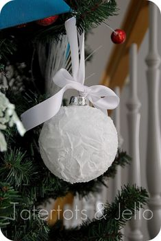 diy snow ball ornaments http://tatertotsandjello.com