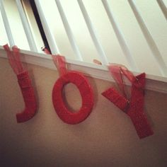 Wrapped letters with yarn and hung them down the staircase.