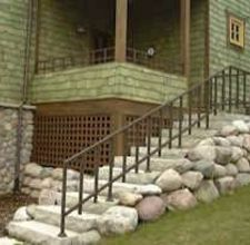 how to install a wrought iron railing into concrete stairs