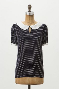 Polka-dotted blouse.