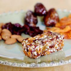 Raw Energy Bars... Came highly recommended by a couple moms with babies for an easy healthy snack on the go.  First batch with 1/2 C mixed nuts, 4 dates, and total of 1/2 C mix of shredded coconut, raisins, and prunes!  sounds gross but it's delicious.  The little one loved it too.