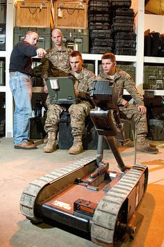 A civilian trainer explains how to setup the operating display for the Pack Bot battlefield robot to soon-to-deploy paratroopers with the 82nd Airborne Division's 1st Brigade Combat Team Jan. 9, 2012, at the Joint Readiness Training Center, Fort Polk, La. The robot features two video cameras and an articulating arm and can be used to inspect objects such as potential roadside bombs from a safe distance. U.S. Army photo by Sgt. Michael J. MacLeod