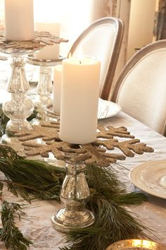 White Christmas table. Love the giant snowflake base that candle is resting on!