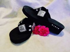 Stylish western cowgirl zebra print bling concho flip flops. Accented with genuine glass crystals.   $40.00  www.pamperedcowgirl.com