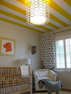 I love the chandelier and the striped ceiling.
