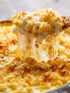 "Garlic Parmesan Mac And Cheese is better than the original! A creamy garlic parmesan cheese sauce coats your macaroni, topped with parmesan fried bread crumbs, while saving some calories! | <a href=""http://cafedelites.com"" rel=""nofollow"" target=""_blank"">cafedelites.com</a>"