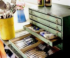 Reuse a tool chest to store kitchen utensils.