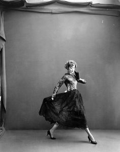 August 1956    Barbara Mullen is wearing Lanvin-Castillo's floaty lace evening dress. Photographed by Richard Avedon.