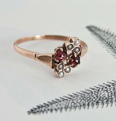 Pearl and Garnet Crossover Ring from Erica Weiner.