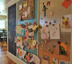 i like this... large wall, part magnetic, part cork board/hanging clips, part chalkboard.