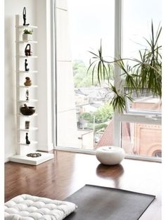 Turn an empty bedroom into a peaceful yoga retreat. Here, natural light and white walls with earth toned accents creates a meditative ambiance. Get more ideas at http://www.lender411.com/featured-article-bust-empty-nest-syndrome-with-a-redecorating-or-remodeling-project-after-the-kids-move-out-lender411-com/.