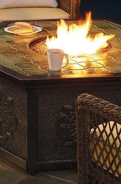 Enjoy great company and conversation late into chilly fall nights around the Villa Custom Gas Fire Table that provides warmth and stylish Moroccan tile counter for convenience.