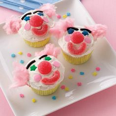 "Love the cotton candy ""hair"" on these clown cupcakes!"