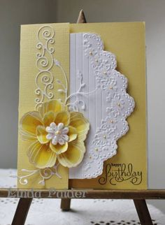 handmade card ... yellow and white ... embossing a die cuts ... sweet dimensional flower ...