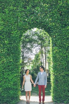 leafy archway for wedding portraits, photo by Studio A+Q http://ruffledblog.com/normandy-summer-wedding #wedding #portraits