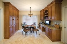 BKC Kitchen and Bath dining room/home office: KitchenCraft Cabinetry