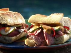 Food Network invites you to try this Grilled Lamb Sandwiches recipe from Guy Fieri.