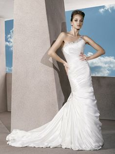 This is one of my wedding dress top pics because of the design and it is complimentary to the  figure. wedding dressses, bridal collection, wedding ideas, satin, gowns, dresses, one shoulder, bubbles, design