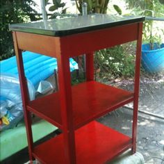 Kitchen cart after. Original enamel top cleaned with Bar Keepers Friend. Cherry red enamel paint