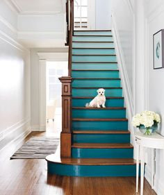 Spice up your stairs. For an ombré effect, choose consecutive colors on the same paint strip.