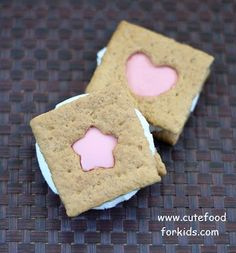 How to Cut Out Shapes on Store Bought Graham Crackers by cutefoodforkids: So cute with candy melts or chocolate in the center. #Graham_Cracker_Cut_Outs #cutefoodforkids food, graham cracker, biscuit, kid