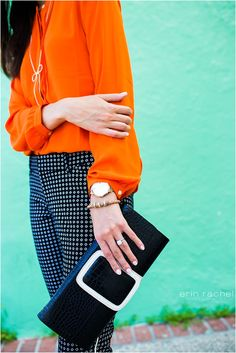 McKenna Trahan of Style Waltz adds a pop of color with a bright orange blouse from Banana Republic.