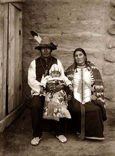 You are viewing an unusual image of Yellow Bone Woman and her Indian Family. It was taken in 1908 by Edward S. Curtis.    The image shows an Indian family with a woman and man in native dress holding baby.    We have created this collection of pictures primarily to serve as an easy to access educational tool. Contact curator@old-picture.com.