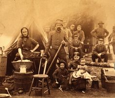 Union soldier with family, holding a surgical saw, Camp of the 31st. Pennsylvania Infantry near Washington, American Civil war. 1862