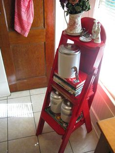 "Red  ladder; no I think it's an ""old"" ironing board"