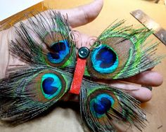 You can use peacock feathers to make a butterfly craft when you create the Funky Peacock Feather Butterfly Ornament. This handmade ornament is a fast, affordable, and fun ornament craft. Attach the feather wings, button face, and wire antennas to make your butterfly.