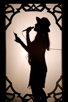 """Feist: a live performance pic from """"The Reminder"""" tour."""