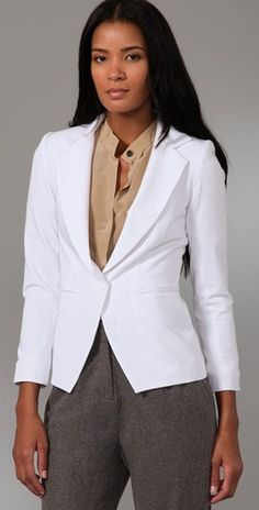 Getting married October 29th, I am a big fan of the idea of a tailored jacket as a topper over the wedding dress.