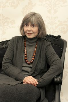 top picks up hair color, jacket and pants and darker shade, necklace contrast in same depth of value - anne rice