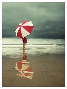 Red & White Beach Umbrella Reflection.