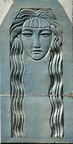 Art Deco Head  Art deco ornamentation on a building on West Elm Street at State Street in Chicago, Illinoi