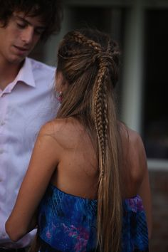 Half up half down, intricate hairdo.