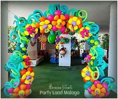 Entrance ways but with pool noodles and paper flowers