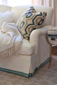 Love this sofa, especially the use of trim along the bottom of the skirt