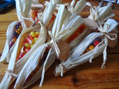 Fall/Thanksgiving treats. Fill pastry bags with candy, wrap them in corn husk used for tamales, and tie. You could even use a decorative ribbon. Fun idea, and cheap to make.