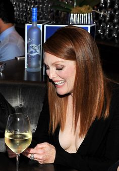 Julianne Moore cleavage in a low cut black dress at TIFF party for Still Alice