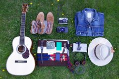 Essentials: John Mayer    visvim items, a Leica M9-P, Hasselblad Xpan, Grado GS1000i Headphones, and an oh-so-necessary Martin 00-45SC Guitar.