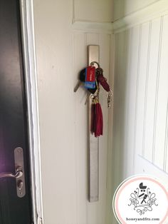 Ikea magnetic knife strip used to hold keys in a mudroom--brilliant!!
