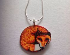 Fox Pendant Necklace. Hand illustrated fox. Hand coloured. Printed onto shrink plastic. On a metal snake chain approx 20cms in length.