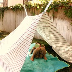 Make a tent outside - tie strips of fabric to tree branches, drape a sheet.
