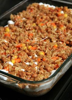 Scarecrow Bars Recipe ~ Cake Mix, Candy Corn, Marshmallows, Peanut Butter, Peanuts, Rice Chex... YUM!