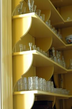 A very Anthropologie way to display glasses, china, and etcetera. Cuter than an old stuffy china cabinet, could be personalized a thousand different ways, and CHEAPER.